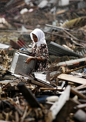 Woman searches through debris where her house once stood, Banda Aceh, Sumatra, Indonesia by simminch