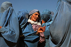 Afghan Women Queue at World Food Programme Distribution Point by United Nations Photo