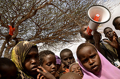 Mohamed Sheikh Ibrahim Speaks with a Megaphone and Tells New Arrivals in Hagadera Refugee Camp, Dadaab by Internewseurope