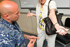 Sailor views Holocaust survivor's prisoner tatoo by Official U.S. Navy Imagery