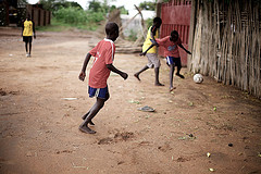 Boys playing soccer by sidelife