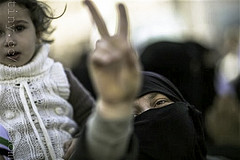 A woman displays a victory sign during an anti-government demonstration in Idlib, north Syria, Friday, March 9, 2012. by FreedomHouse