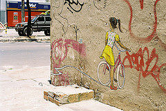 Girl in a bike by Rafael de Oliveira