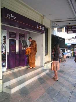 A Thai monk at an ATM